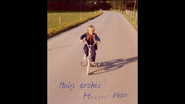 Reto Scherrer als Kind auf einem Velo.
