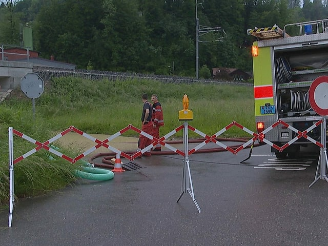 Fire brigade in front of the flooded underpass