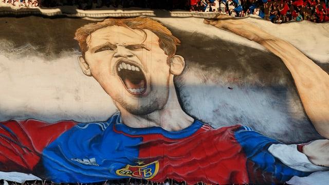Fans halten ein Plakat von Marco Streller in die Höhe