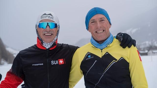 Gian Jörger e Marco Membrini a Spligia vid trenar passlung. Mal'aura.