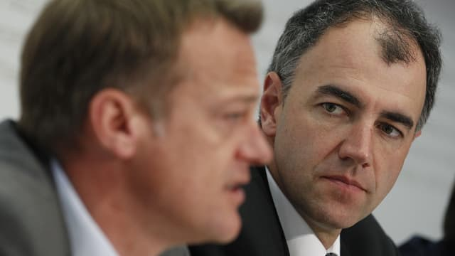 Il president da la PBD Martin Landolt (sanester) ed il president da la PCD Christophe Darbellay.