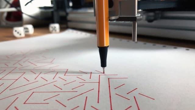 Ein Stift zeichnet Striche.