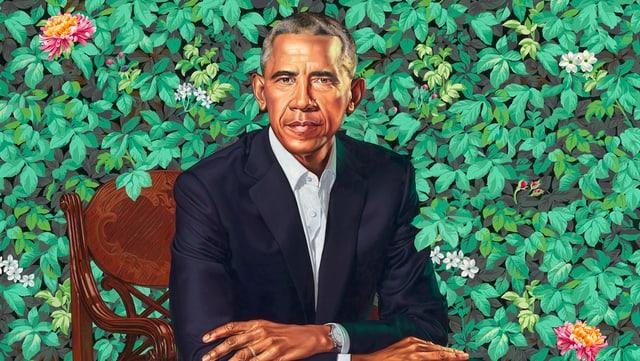 Das Porträt von Obama. Er sitzt vor einem grünen Busch.