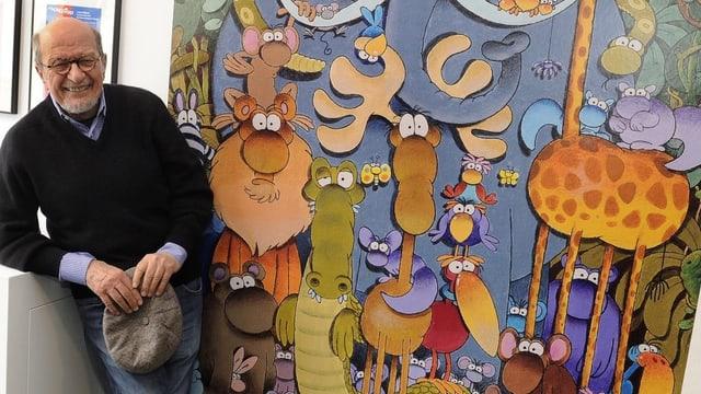 Cartoonist Mordillo neben einer seiner Zeichnungen