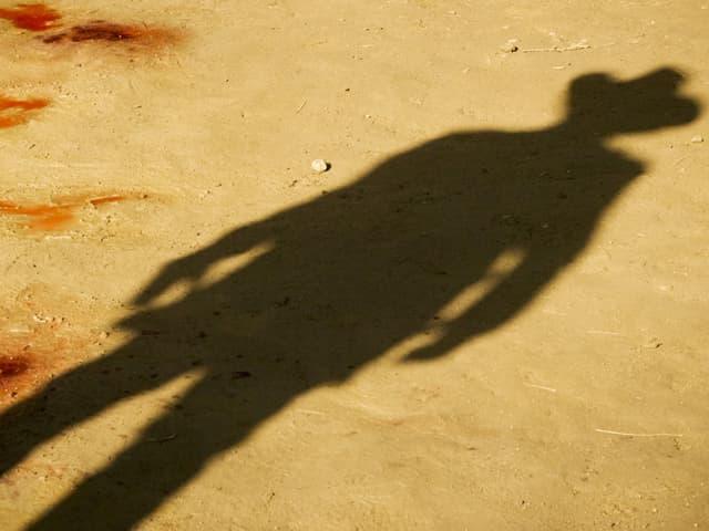 Der Schatten eines Cowboys, Blutflecken im Wüstensand