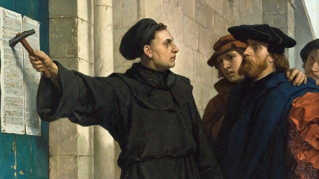 Luther schlägt seine Thesen an.