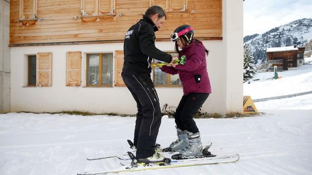 Maletg simbolic: Fusiun da las scolas da skis da Scuol e Ftan.