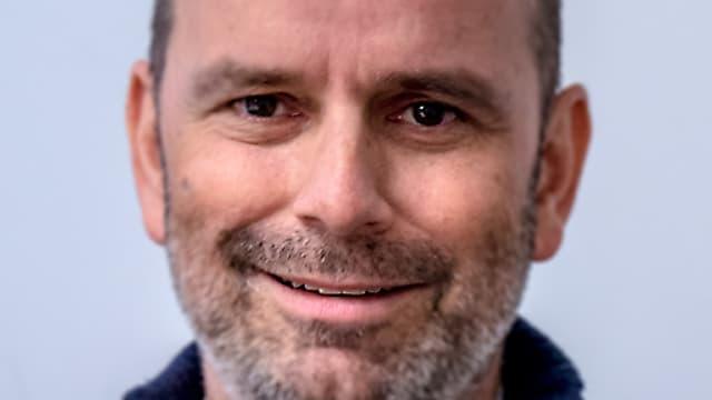 Gesicht eines Mannes mit Bart.