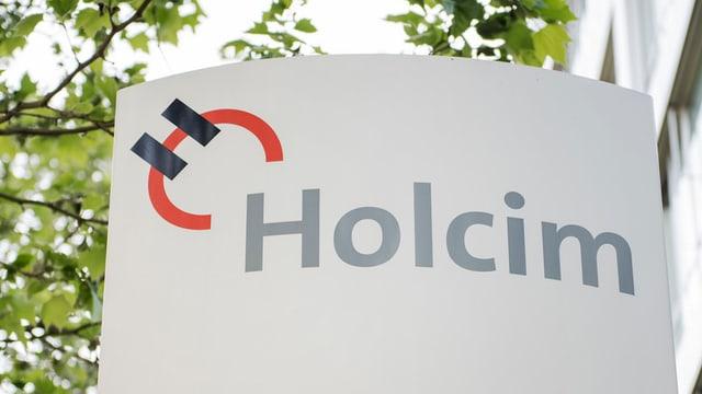 Il logo da Holcim avant la Fusiun cun Lafarge.