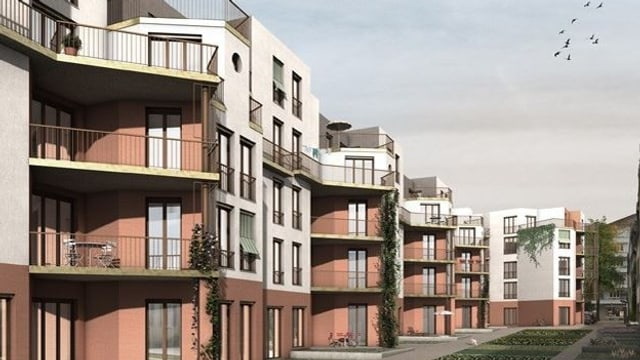 Modellbild der geplanten Siedlung Hornbach: Vierstöckige terrakotta-weisse Mehrfamilienhäuser.