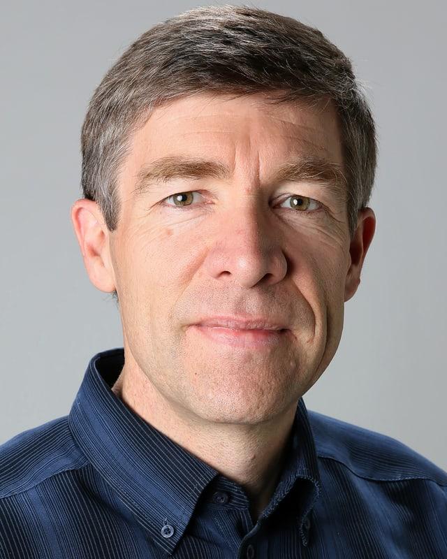 Portraitaufnahme von Prof. Philippe Thalmann