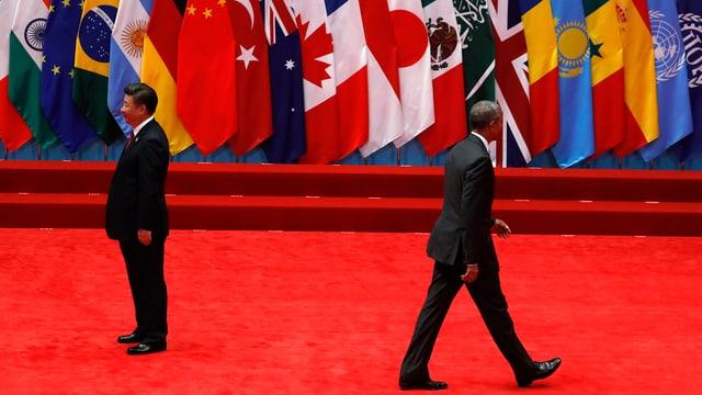 Il president chinais Xi Jinping (dretg) ed il president american Barack Obama (sanester).