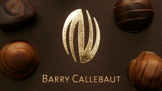 Logo da Barry Callebaut e pralinas.
