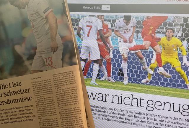 Zeitungs-Ausschnitte.