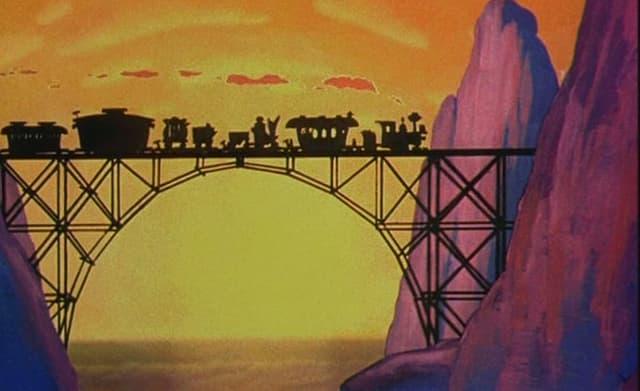 Eine Lokomotive fährt in den Sonnenuntergang.