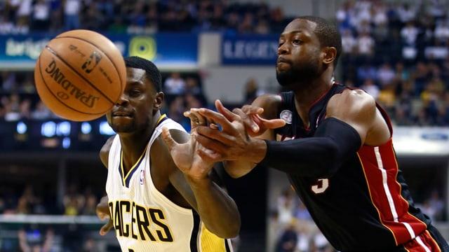 Indiana Pacers' Lance Stephenson und Miami Heat's Dwayne Wade.