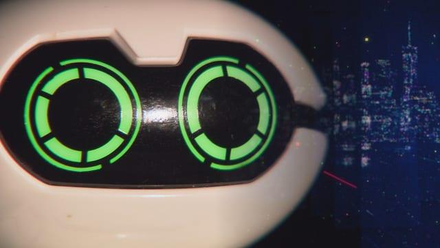 Il chau d'in roboter da termagls cun egls verds.
