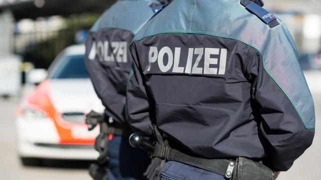 Dus polizists da la Polizia chantunala grischuna