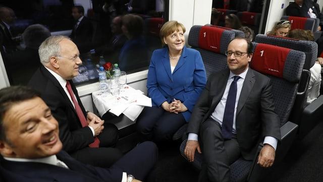 Johann Schneider-Ammann (zweiter von links) mit Bundeskanzlerin Angela Merkel, Staatspräsident François Hollande und Premierminister Matteo Renzi im Eröffnungszug am 1. Juni 2016.