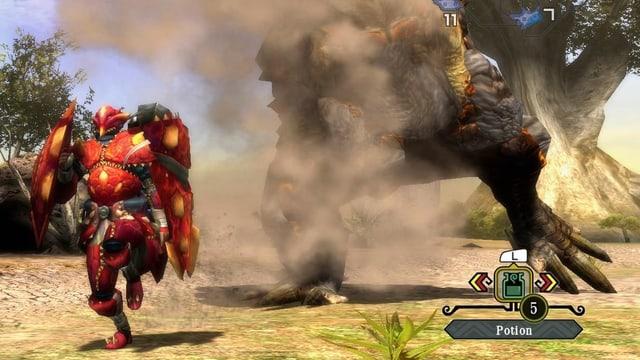 Ein Jäger in roter Rüstung flüchtet vor einem stampfenden Urviech.