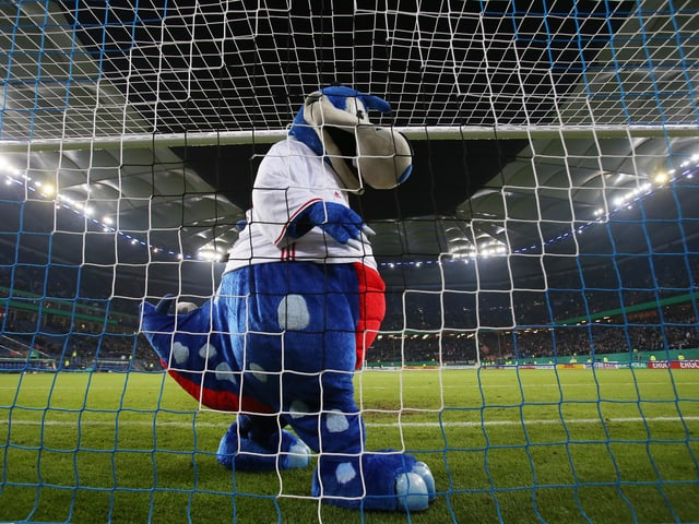 «Dino Hermann», das HSV-Maskottchen.