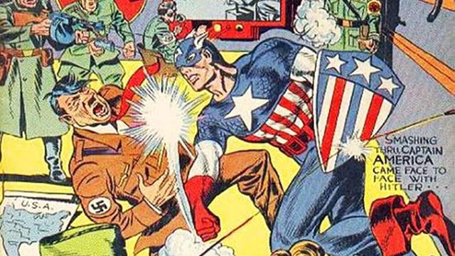 Eine Comic-Zeichnung: Ein Mann in engem Anzug und mit Maske verpasst Hitler einen Schlag ins Gesicht.