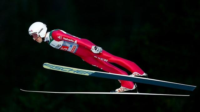 Simon Ammann siglia cun skis