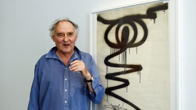 Harald Naegeli neben seinem Bild «Das Auge».