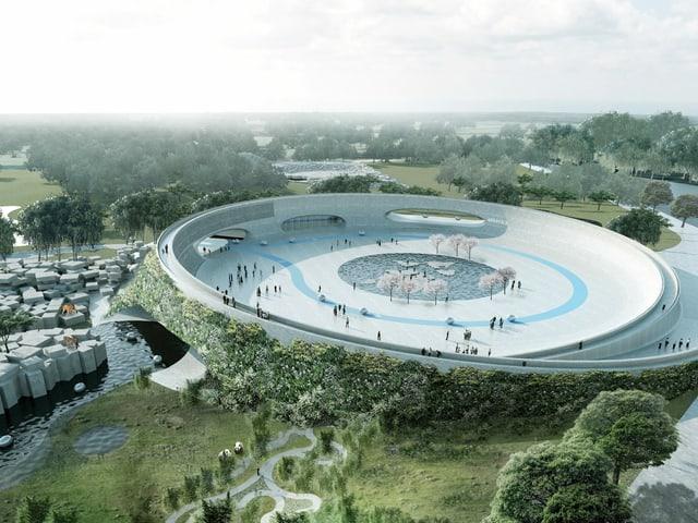Luftaufnahme eines futuristisch anmutenden runden Platzes inmitteln einer grünen Landschaft.