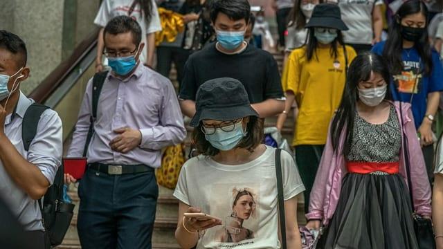 Menschen in Peking am 20. Juni