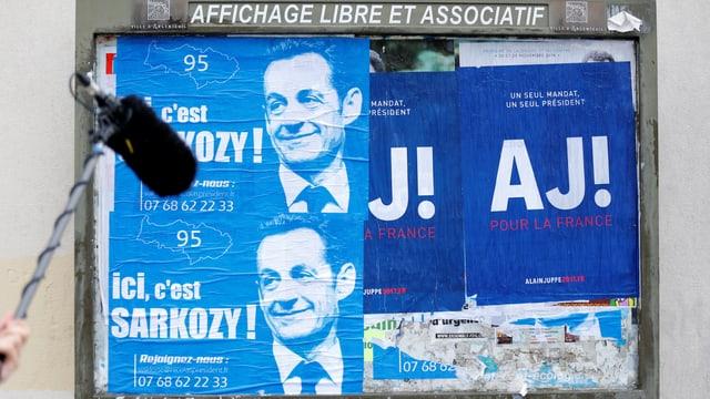 Wahlplakate von Sarkozy und Juppé