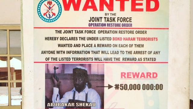 Ein Plakat zur Verhaftung des Boko Haram-Anführers.