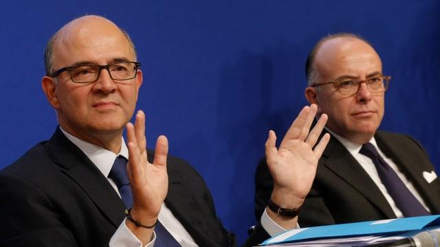 Frankreichs Finanzminister Pierre Moscovici (links) und Budgetminister Bernard Cazeneuve präsentieren das Budget 2014.
