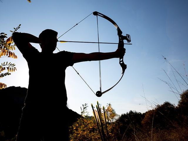 Silhouette eines Bogenschützen.