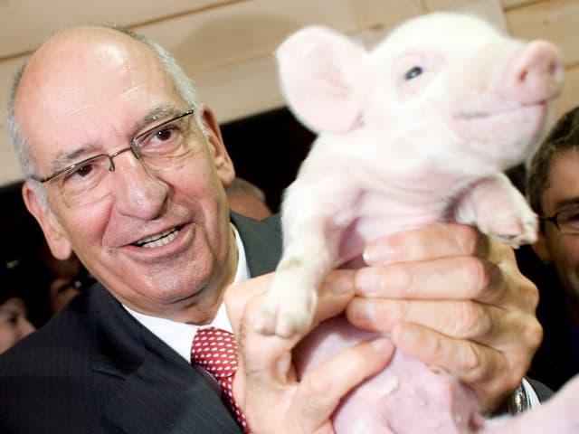 Couchepin mit Schweinchen.