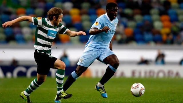 Kolo Touré (r.) verlässt Manchester City und wird neu für Liverpool auflaufen.