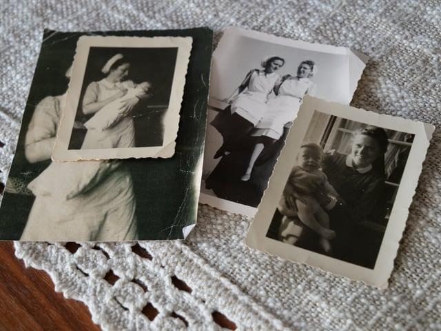 Alte Fotos mit einer Kinderschwester in Schwesterntracht mit Baby auf dem Arm.