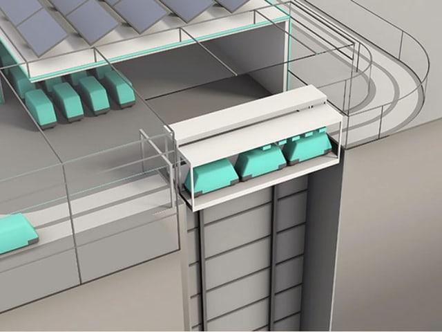 CST-Fahrzeuge werden mit einem Lift in den Tunnel befördert.