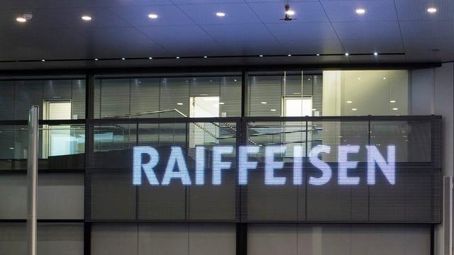 logo da Raiffeisen vid ina paraid en ina sala da sesida