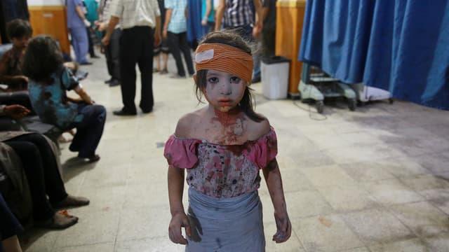 Ein blutbeschmiertes Mädchen.