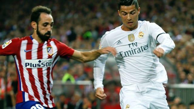 Atleticos Juanfran und Reals Cristiano Ronaldo.