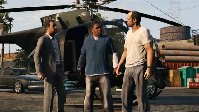 Die drei Protagonisten von «Grand Theft Auto V» stehen vor einem Helikopter und diskutieren.