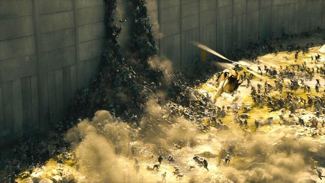 Tausende von Zombies türmen sich an einer Mauer auf.