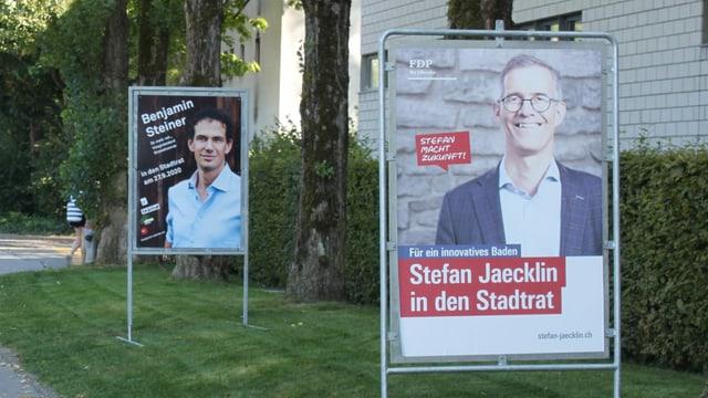 Wahlplakate zweier Politiker.