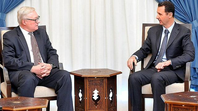 Russlands Vize-Aussenminister und der Präsident von Syrien im Gespräch.