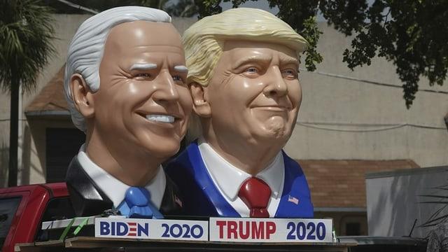 Köpfe von Trump und Biden als Skulpturen.