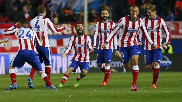 Ils giugaders d'Atletico Madrid suenter la victoria.
