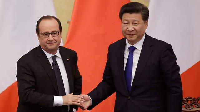 François Hollande e Xi Jinping.