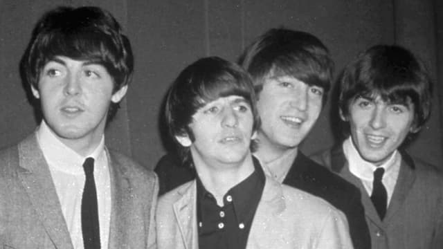 ils Beatles l'onn 1963.