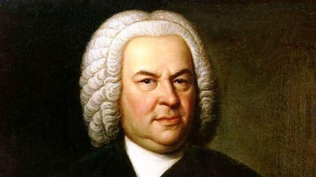 Man sieht ein Porträt von Johann Sebastian Bach, gemalt von Elias Gottlob Hausmann.